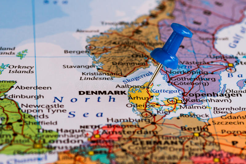 Map of Denmark. With a blue pushpin stuck stock photos