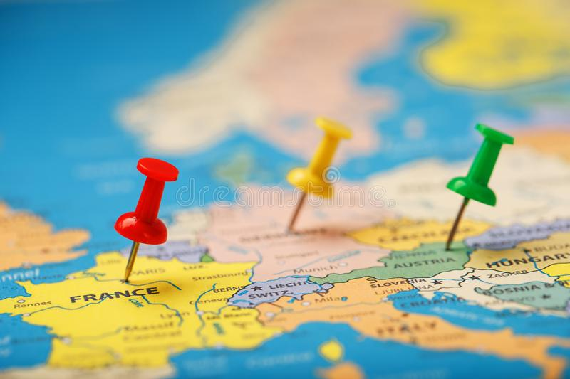 On the map of Europe, the colored buttons indicate the location and coordinates of the destination. Country Policy Concept royalty free stock images