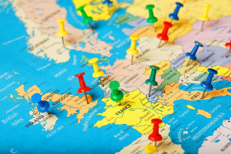 On the map of Europe, the colored buttons indicate the location and coordinates of the destination. Country Policy Concept stock image