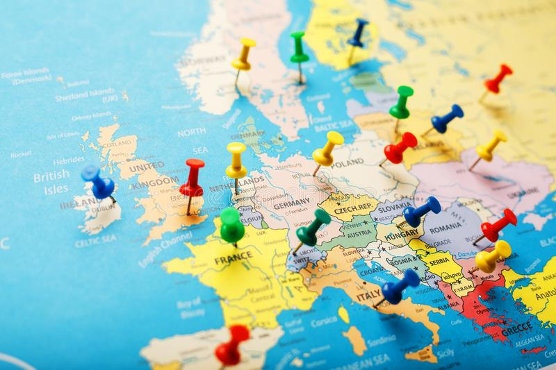 On the map of Europe, the colored buttons indicate the location and coordinates of the destination. Country Policy Concept royalty free stock photos