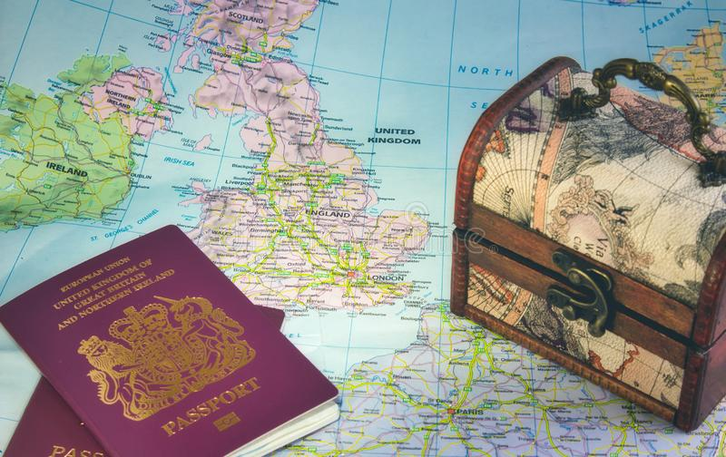 Map of Europe showing the UK, England, Ireland, France, British passports and a chest representing Brexit royalty free stock photo