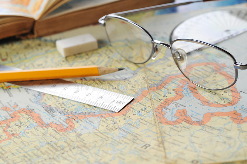 Map and glasses royalty free stock photo