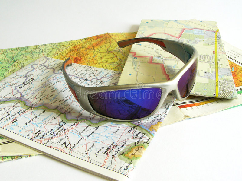 Map and glasses stock images