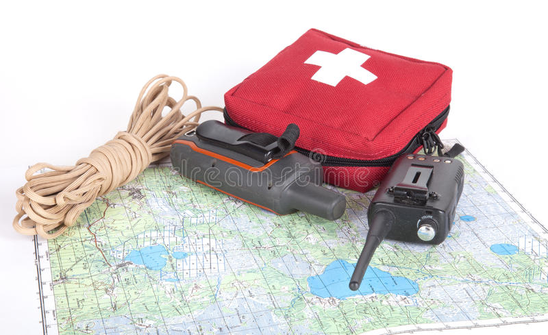 Map, gps navigator, portable radio, rope and first aid kit on a. Light background. Set lifeguard stock image