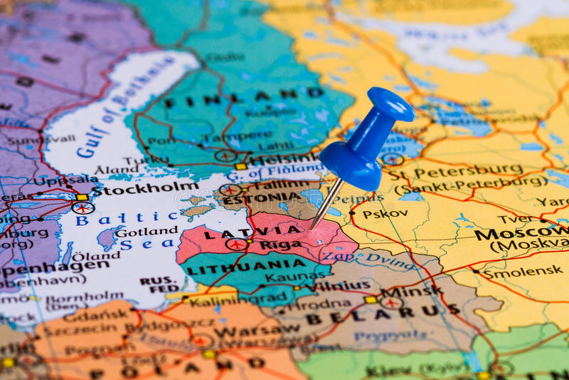 Map of Latvia. With a blue pushpin stuck stock photos