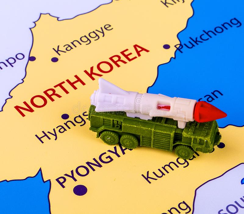 Map of North Korea with a military machine. With an intercontinental missile stock photo