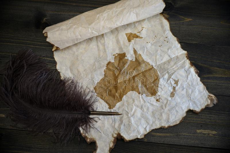 Map of oceania on vintage paper with old pen on the wooden texture desk. Background royalty free stock photography