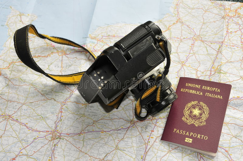 Map, passport and camera. Preparing for a trip stock photos