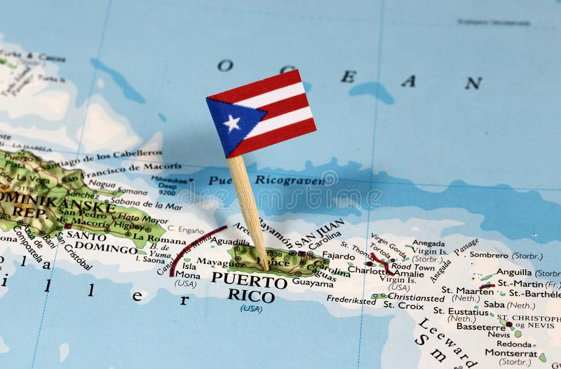 Map with pin point of Puerto Rico. With flag stock photo