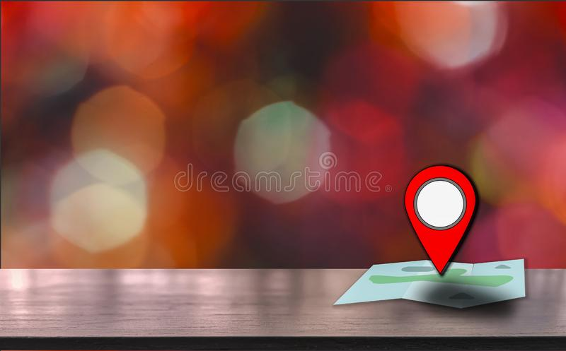 Map pointer icon placed on a wooden table, background is bokeh at night, With the concept of using technology to help travel and royalty free stock image