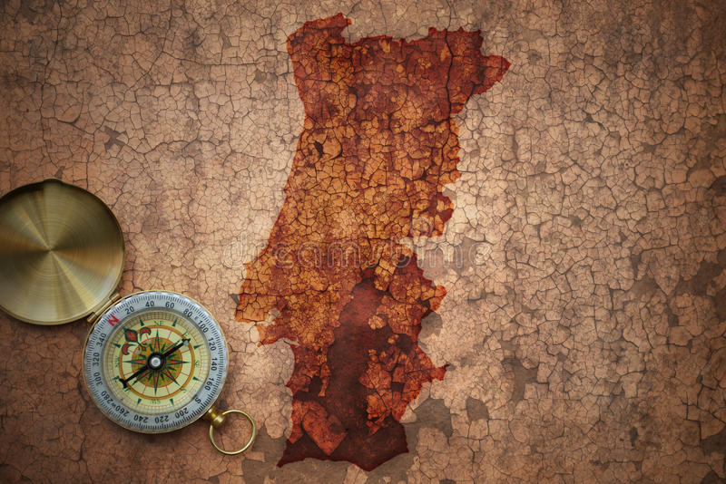 Map of portugal on a old vintage crack paper. Background with compass royalty free stock images