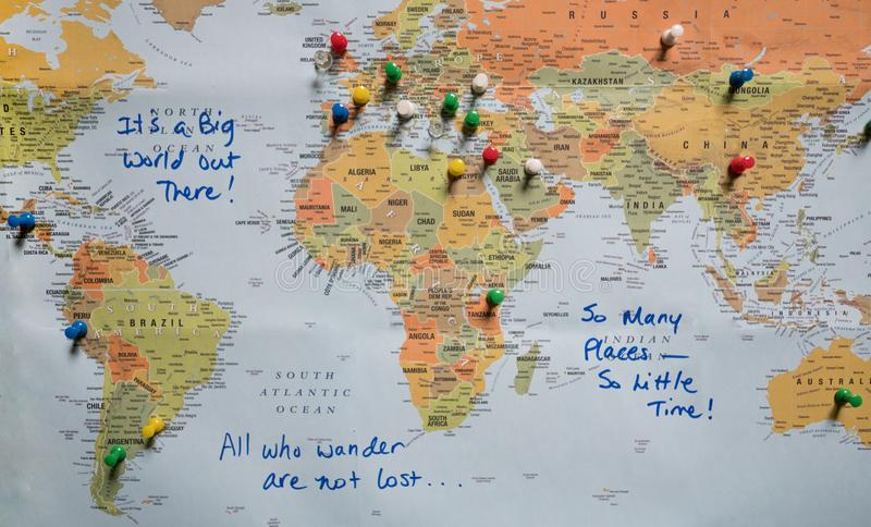 Map with Push Pins and Travel Quotes. A world map with travel quotes and countries identified with push pins. Photographed from above stock photos