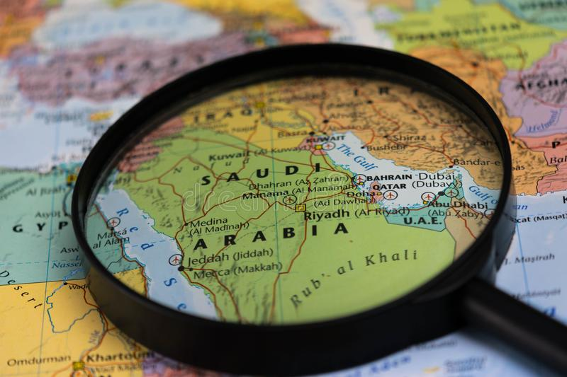 Map of saudi arabia through magnifying glass on a world map stock download map of saudi arabia through magnifying glass on a world map stock photo gumiabroncs