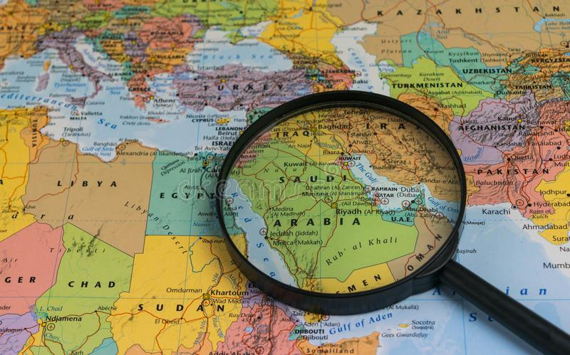 download map of saudi arabia through magnifying glass on a world map stock image