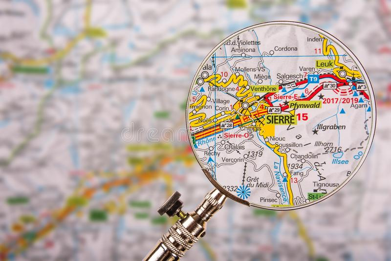 Map of Sierre Siders with magnifying glass on table. Map of Sierre Siders with magnifying glass and blured focus royalty free stock photos