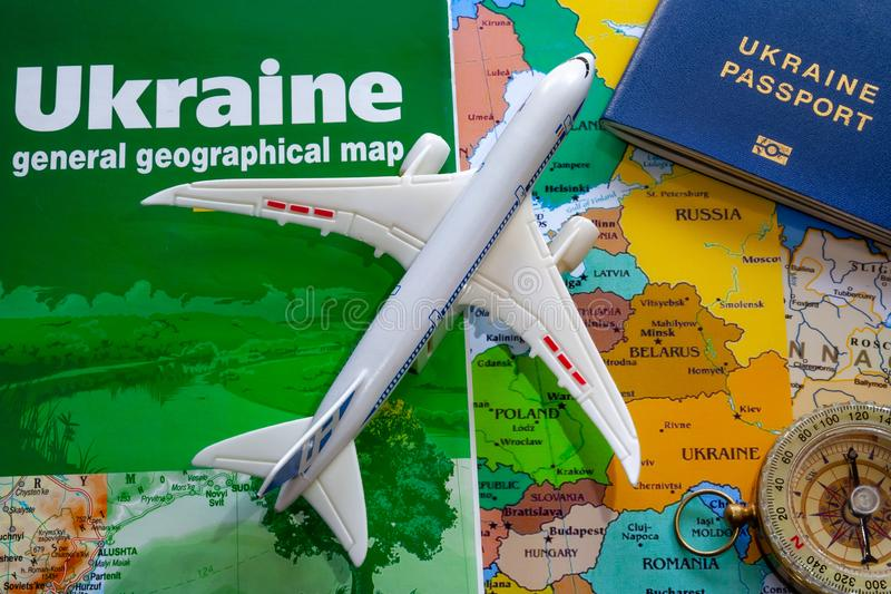 Map of ukraine with a passport and plane boeing for travel.  stock photography