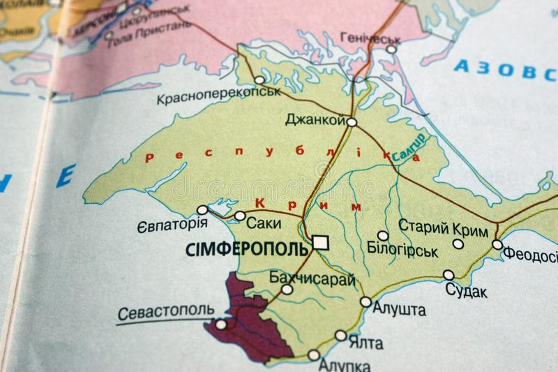 Map view of Crimea, Simferopol on a geographical map of Europe. Close-up with blur. Map view of Crimea, Simferopol on a geographical map of Europe, background stock photos