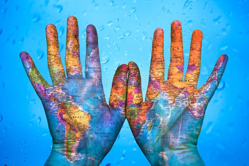 The map of the world on hands royalty free stock photography