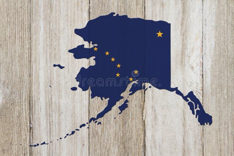 Mapa de Alaska nas cores da bandeira de Alaska imagem de stock