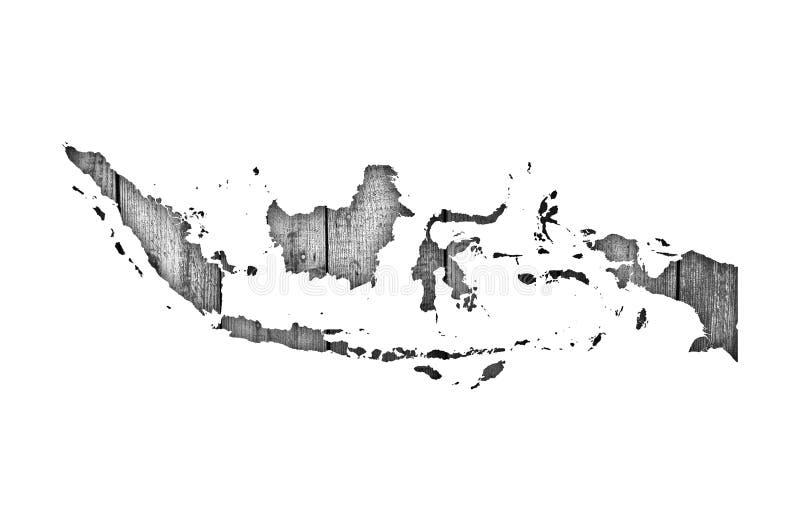 Mapa de Indonésia na madeira resistida ilustração stock