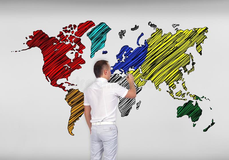 Mapa del mundo del dibujo del hombre de negocios imagen de archivo libre de regalías