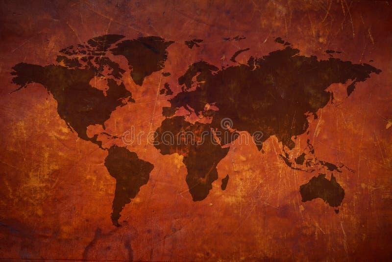 Mapa del mundo en el cuero del vintage imagenes de archivo