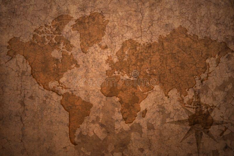 Mapa del mundo en un viejo fondo del papel del vintage imagen de archivo libre de regalías