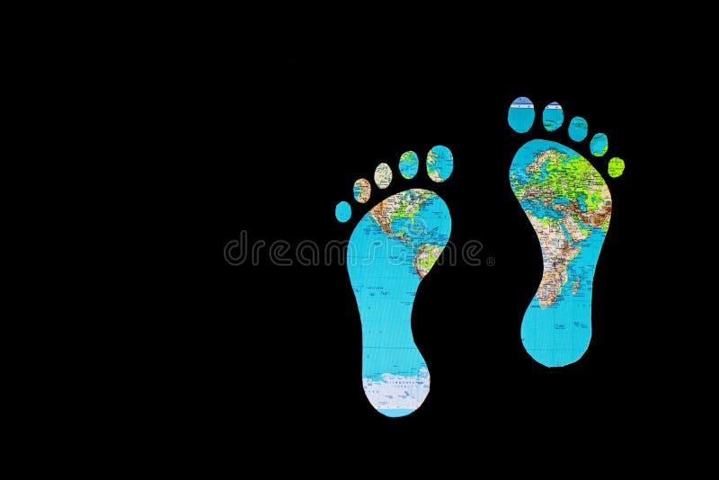 Mapa del mundo y huellas imagen de archivo libre de regalías