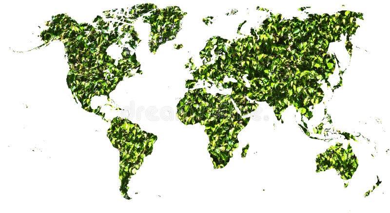Mapa do mundo cortado nas folhas verdes fotografia de stock