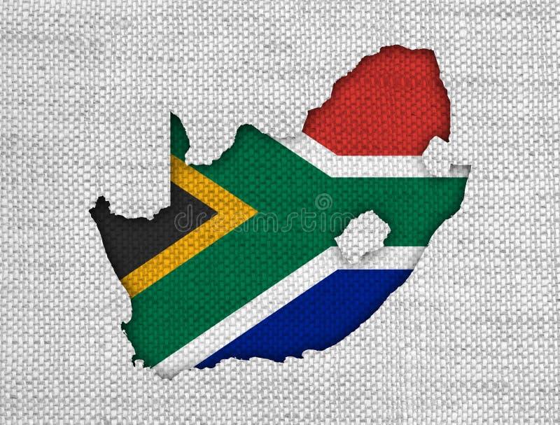 Mapa e bandeira de África do Sul no linho velho imagem de stock