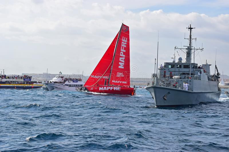 Mapfre Very Close Between Warship And Spectator Boats Volvo Ocean Race Alicante 2017 stock photo