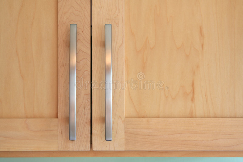 Maple doors and handles royalty free stock photo