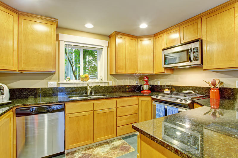 maple kitchen cabinets with black appliances. Download Maple Kitchen Cabinet With Black Granite Tops Stock Image - Of Maple, Interior Cabinets Appliances W