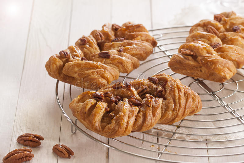 Maple pecan. Danish pastry maple pecan with nuts and maple syrup stock images