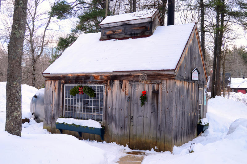 A maple sugar house in winter. A maple sugar House sits deep in the woods of New England royalty free stock image