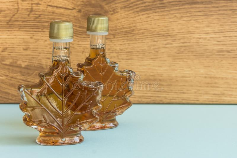 Maple syrup in a bottle maple leaf shape. royalty free stock images