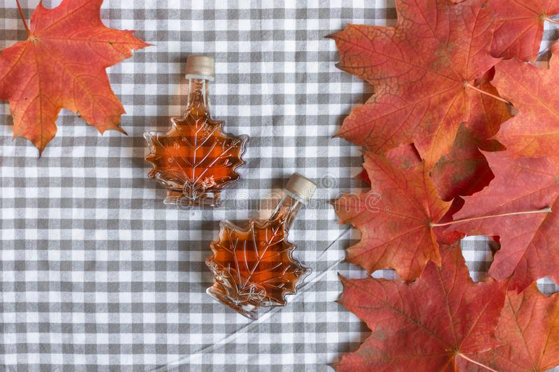 Maple syrup in a bottle in a shape of maple leaf. stock photos