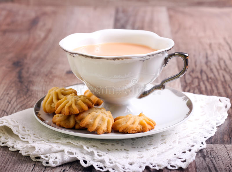 Maple syrup butter cookies. On plate and drink royalty free stock photo