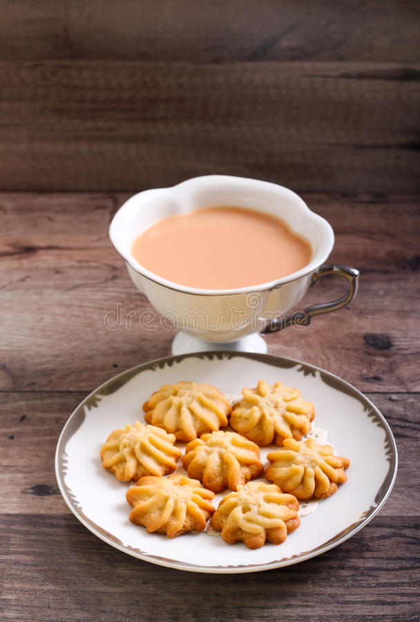 Maple syrup butter cookies. On plate and drink royalty free stock images