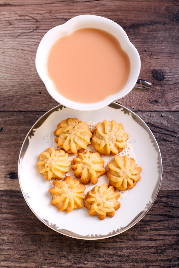 Maple syrup butter cookies. On plate and drink stock photos