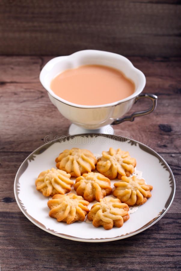 Maple syrup butter cookies. On plate and drink royalty free stock photos