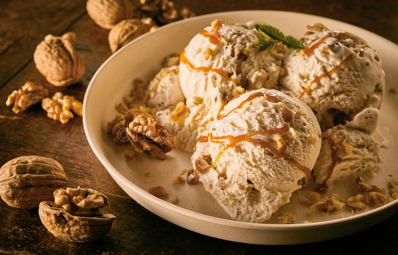 Maple Walnut Ice Cream with Caramel Sauce in Bowl royalty free stock photo