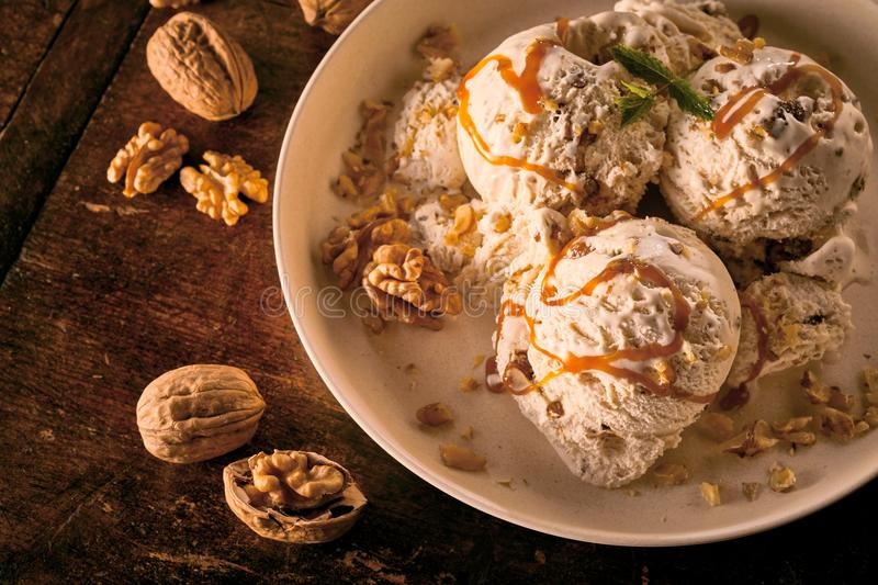 Maple Walnut Ice Cream with Caramel Sauce in Bowl stock photography