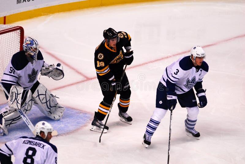 Mapleleafs v. Bruins. Bruins forward Tyler Seguin plants himself in between Leafs defenseman Dion Phaneuf and goalie Jonas Gustavsson stock images