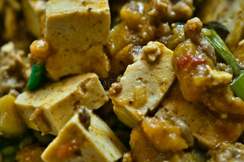 Mapo Doufu also known as Mapu Tofu, a spicy Asian dish made from minced meat and tofu cubes with spring onions and lots of chili, stock photo