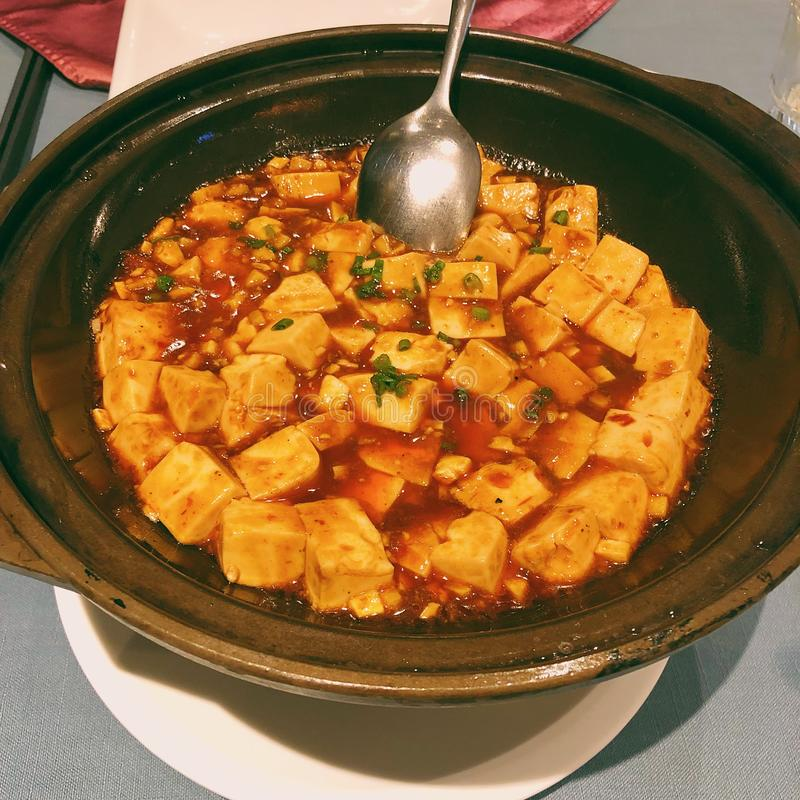 Mapo Tofu. There is a story about this dish.A long time ago, there was a wife whose face was covered with pockmarks.People call her Mapo.Because she is ugly, no stock images