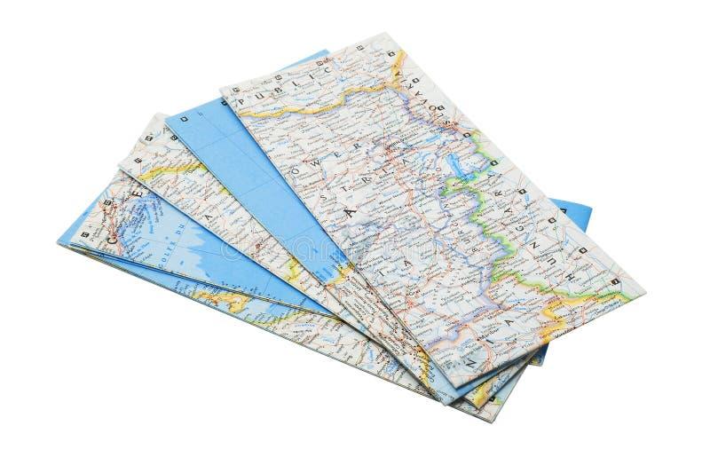 Maps. Folded tourist maps isolated on white royalty free stock images