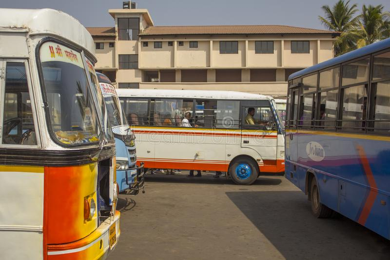Indian People in the white bus at the bus station among other multi-colored buses, modern royalty free stock photo