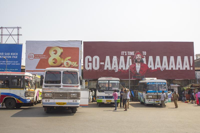 White Indian buses stand in a row at the bus station on the background of billboards and people stock photos