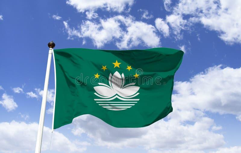 Maqueta de la bandera de Macao, agitando debajo del cielo azul fotos de archivo libres de regalías